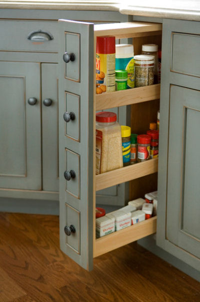 Slide out mini kitchen pantry. Great idea!