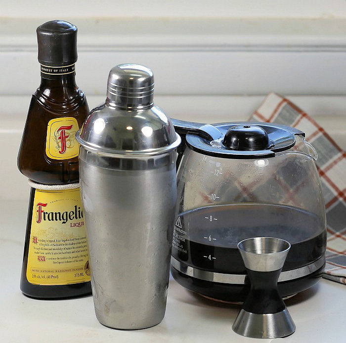 Making a coffee vodka cocktail in a cocktail shaker