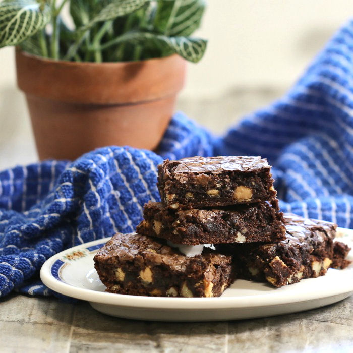Plate of Rich chocolate brownies with peanut butter and pecans