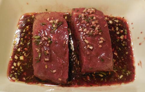 steaks marinading