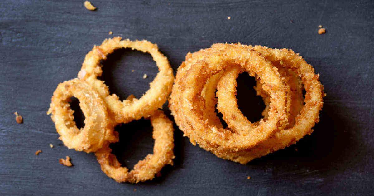 crispy onion rings in a row.