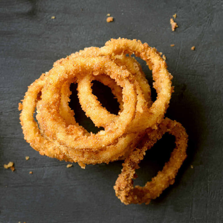 baked onion rings in a plile.