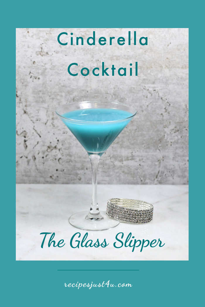 Blue cocktail in a martini glass with a glass slipper and words Cinderella cocktail - The Glass Slipper.