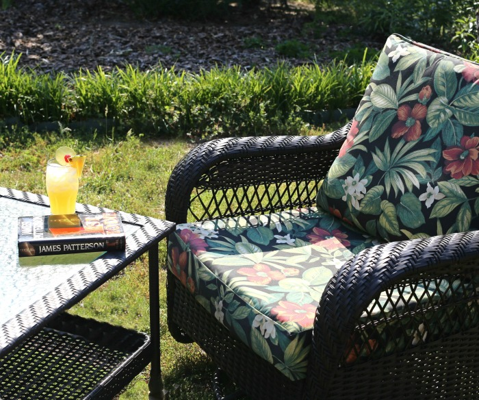 Patron tequila recipe, book and patio chair