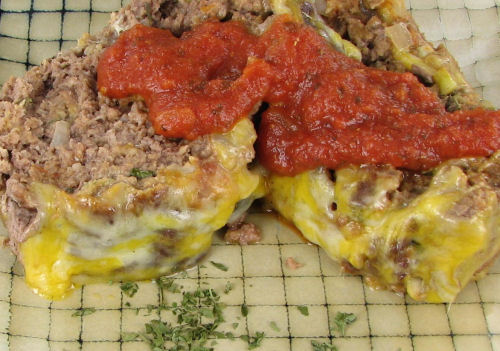 Slice of Meatloaf with Parmesan cheese and marinara sauce