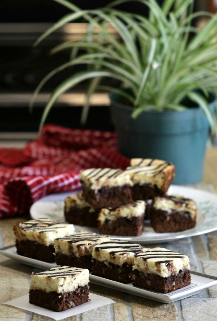 Plates of cheesecake brownie bars