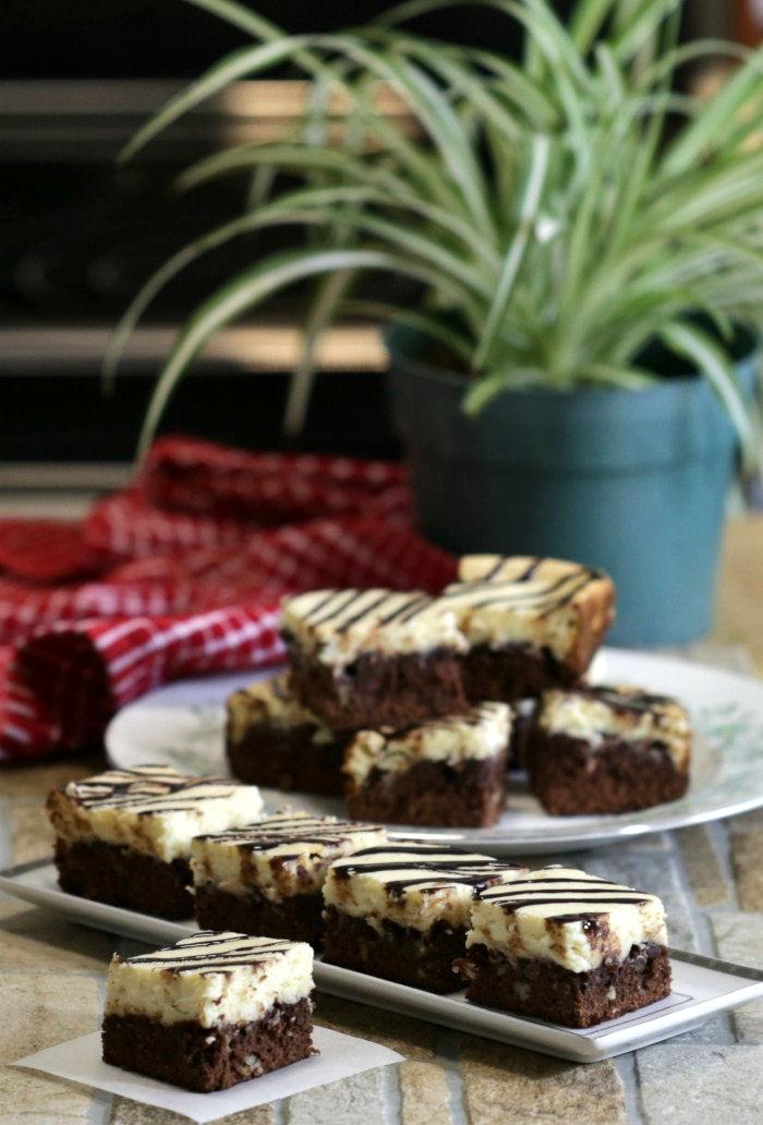 Plates of cheesecake brownie bars