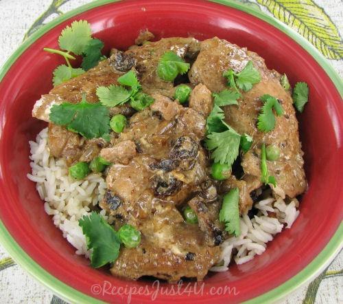 Milk chicken curry over rice