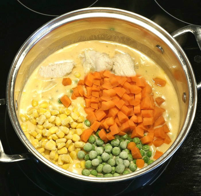 Adding vegetables to the homemade chicken pot pie soup