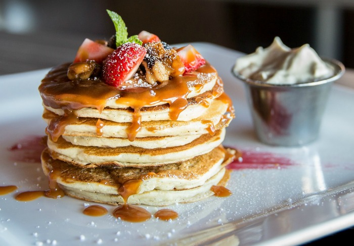 Stack of pancakes with fresh toppings