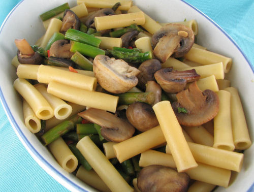 Ziti pasta with mushrooms and asparagus.