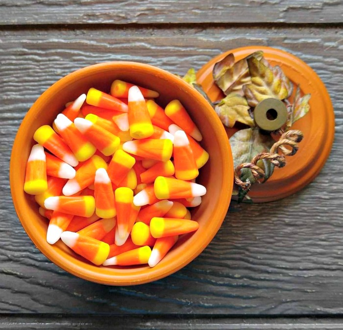 Candy corn in a clay pot pumpkin candy dish