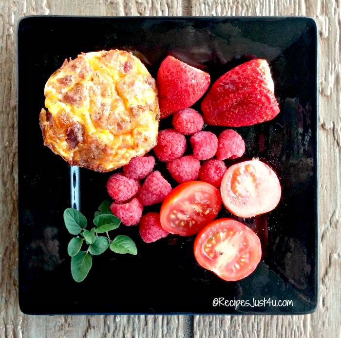 Breakfast egg muffins, fresh fruit and campari tomatoes