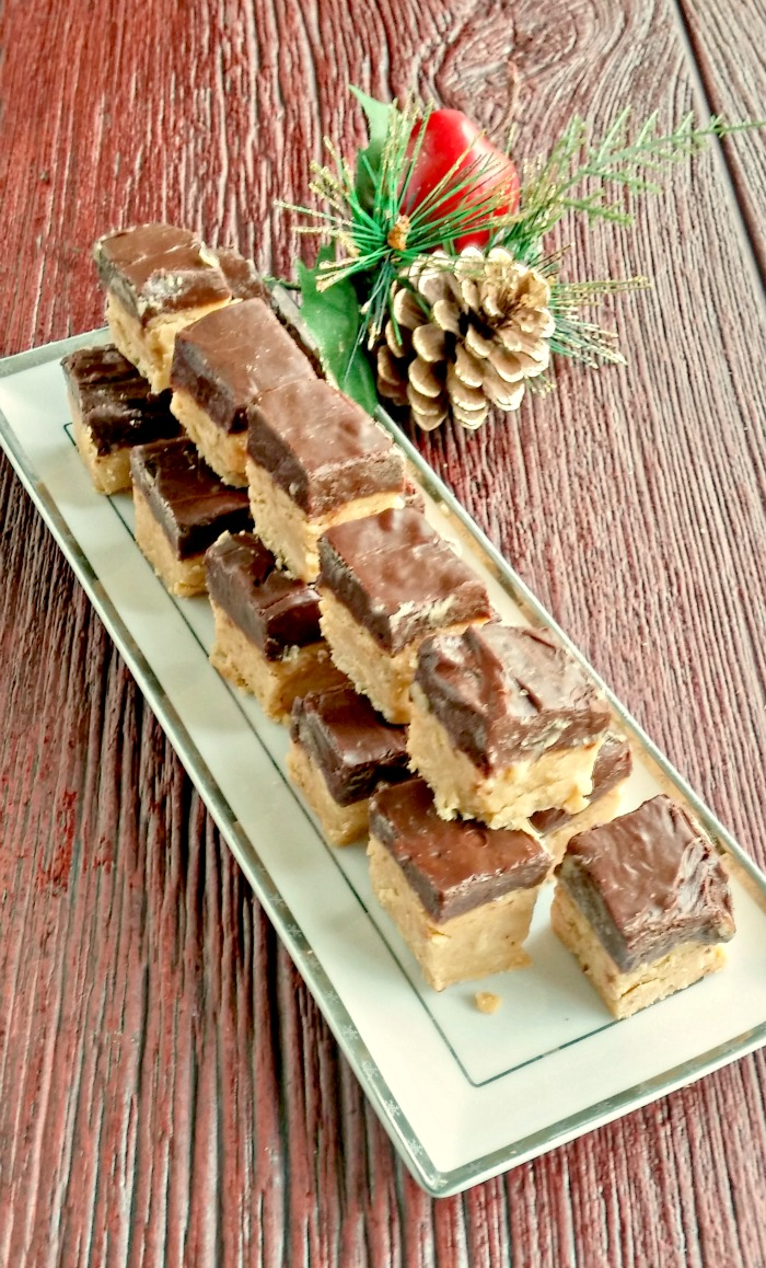 This easy to make buckeye fudge has all of the flavors of buckeye balls without the work. It's ready to set in about 10 minutes and foolproof. recipesjust4u.com