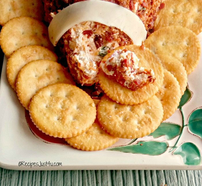 close up of the spicy football cheese ball on crackers