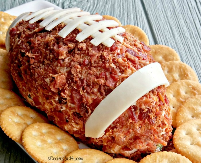 decorating the football cheese ball