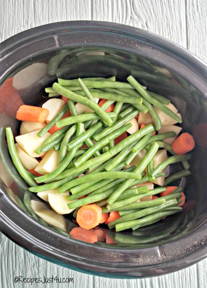 add vegetables to the crock pot