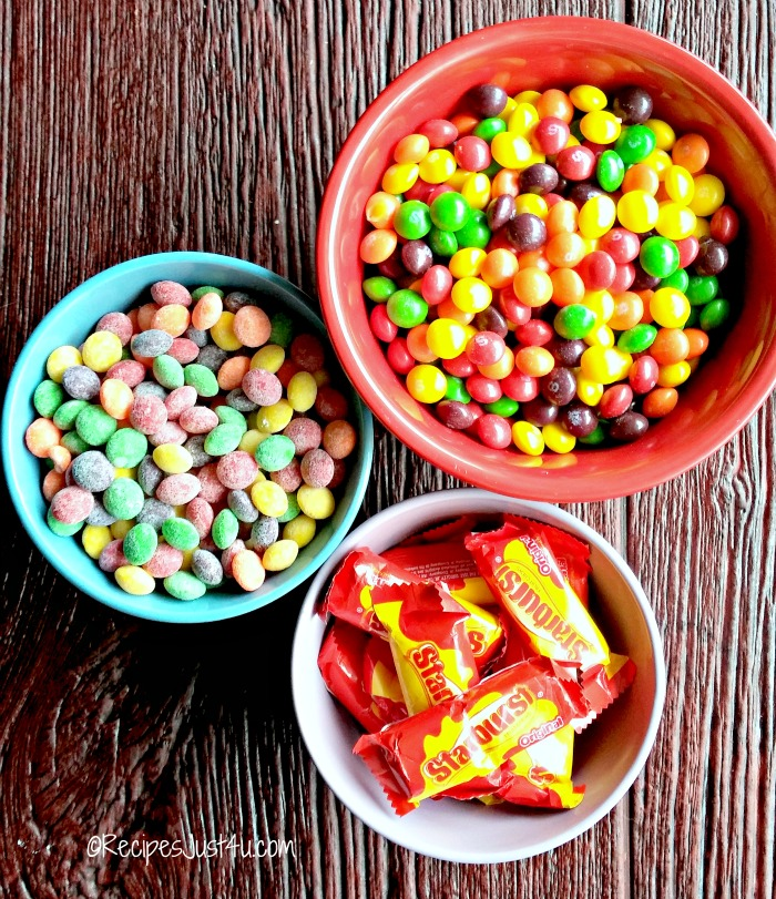 Bowls of skittles candy and Starburst