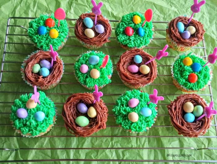 Easter cupcakes make with grass frosting, and nests with M&M's® Pastel peanuts