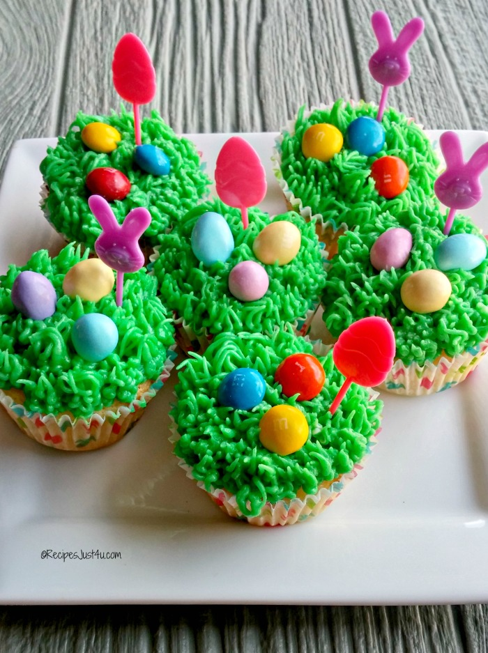 Lemon cupcakes with grass frosting and M&M's® Pastel Peanuts