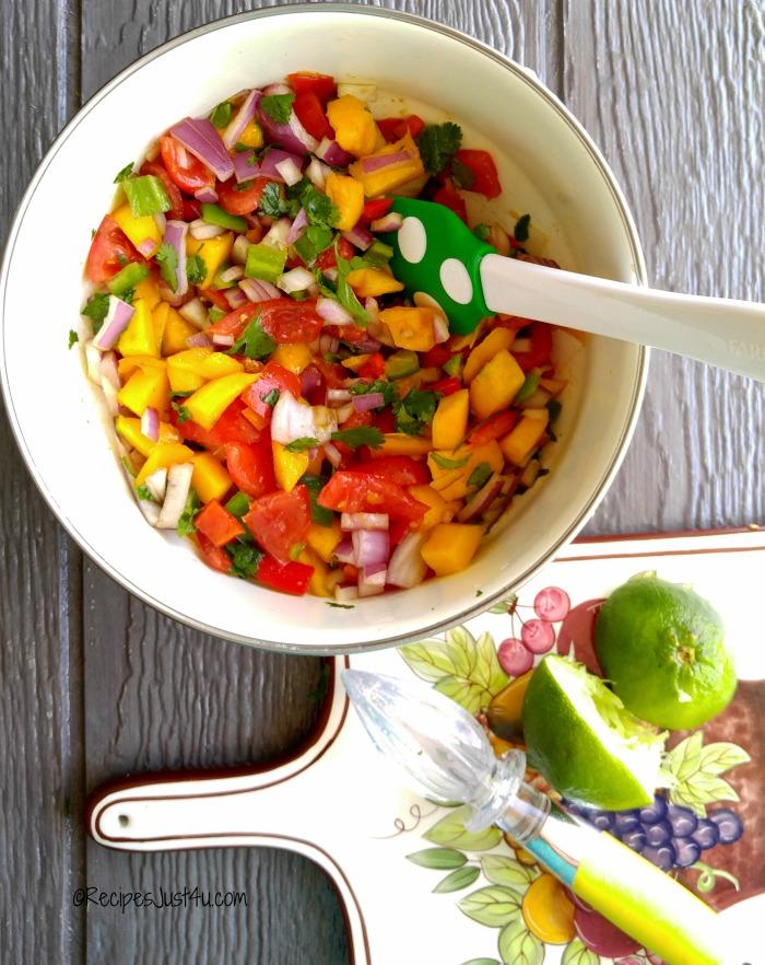 MIxing the mango salsa