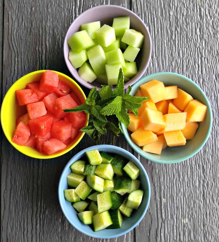 Cube the melon and cucumbers into even sized pieces