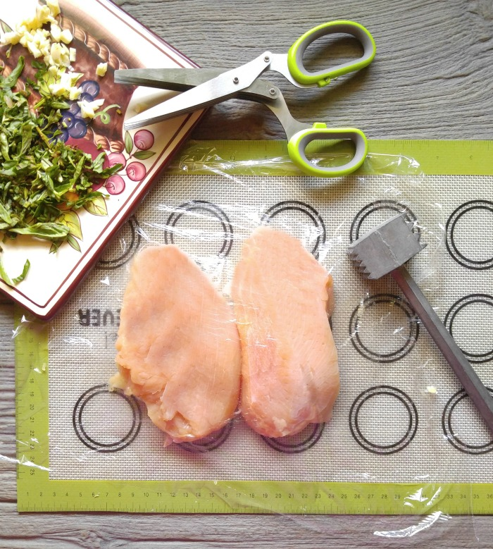 Pound the chicken until about 1 inch evenly throughout
