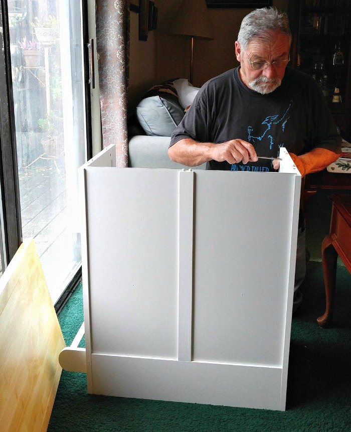 Richard putting together a movable island for my kitchen