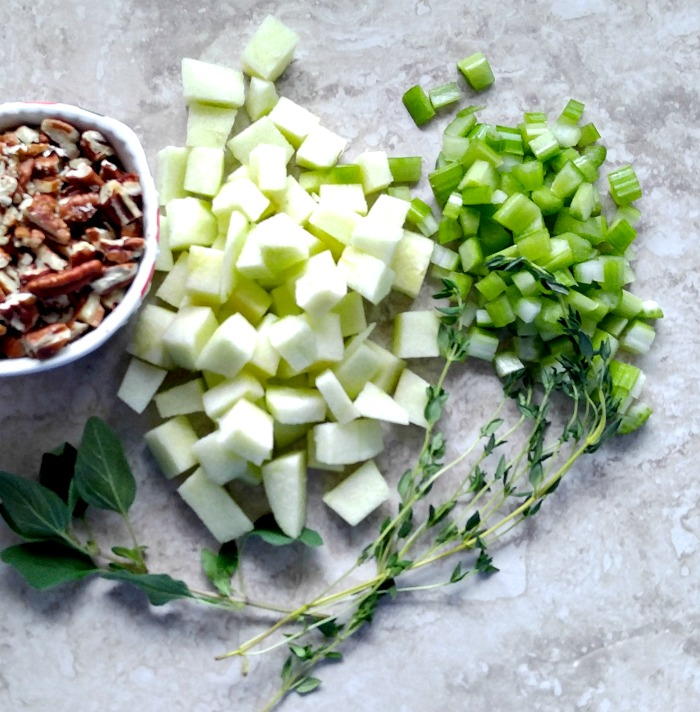 chopped apples and celery with nuts and herbs