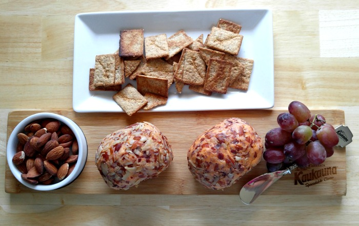 Kaukauna cheese board with crackers, almonds and grapes