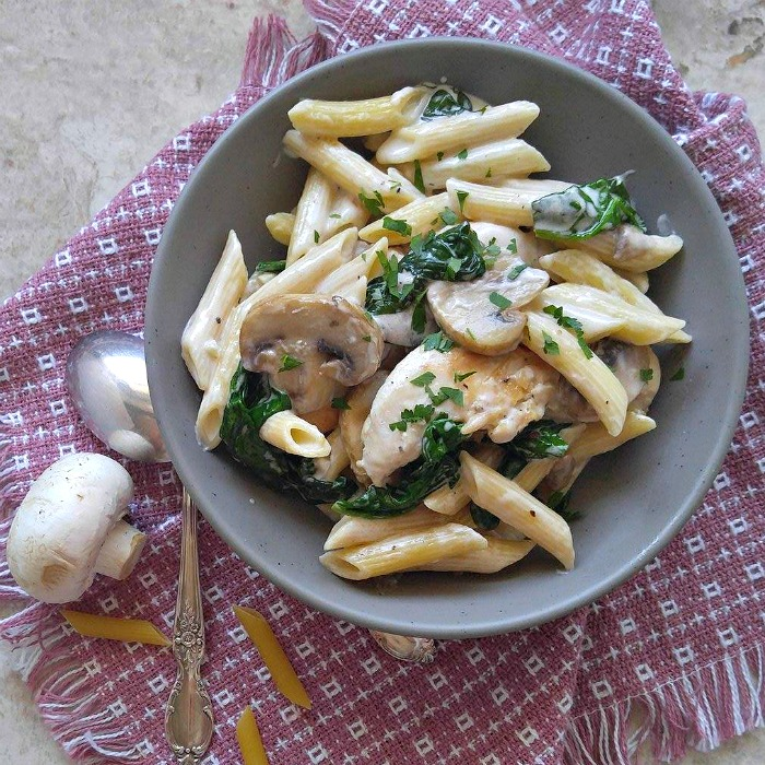 Bowl of chicken and penne in a cream sauce