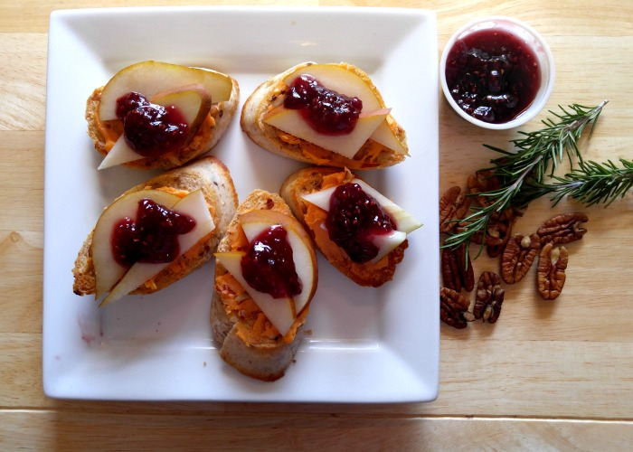 Pears, pecans and raspberry preserves give this crostini appetizer a sweet taste.