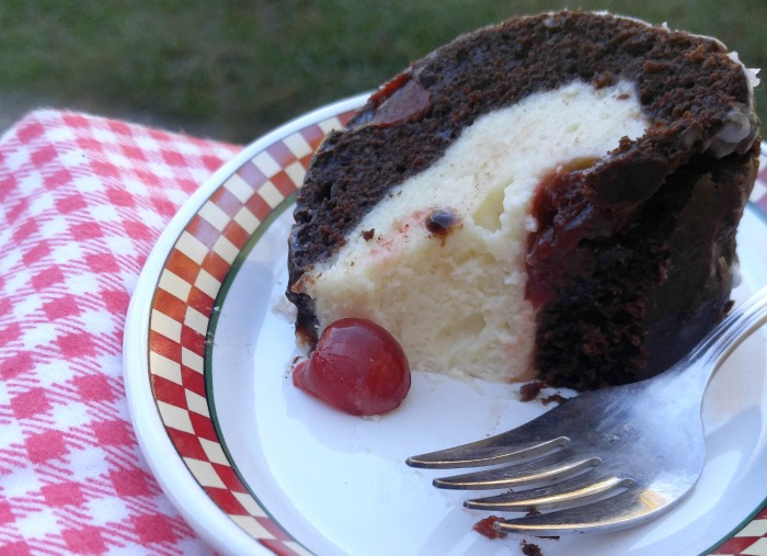 Take a bite of this Chocolate Cherry Cheesecake Bundt Cake