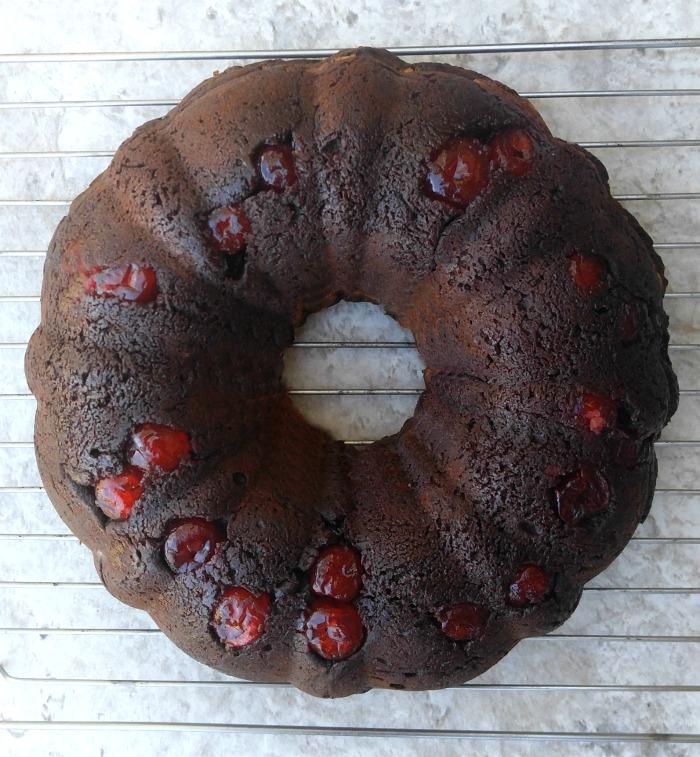 Cherry chocolate cheesecake bundt cake cooling