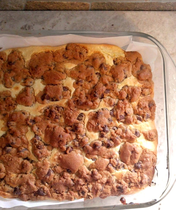 Finished pan of baked chocolate chip cheesecake bars