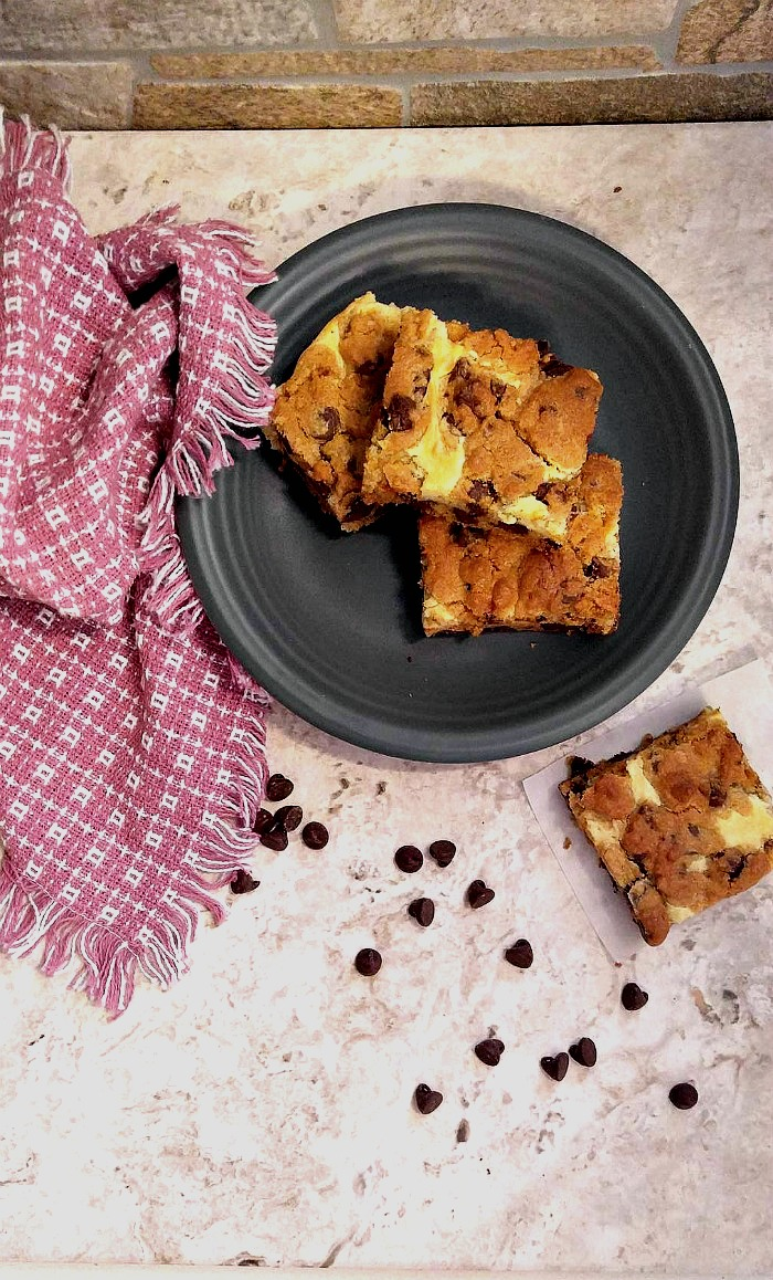 These Chocolate Chip Cheesecake Bars are a cross between a cheesecake and cookies and have the most amazing texture.