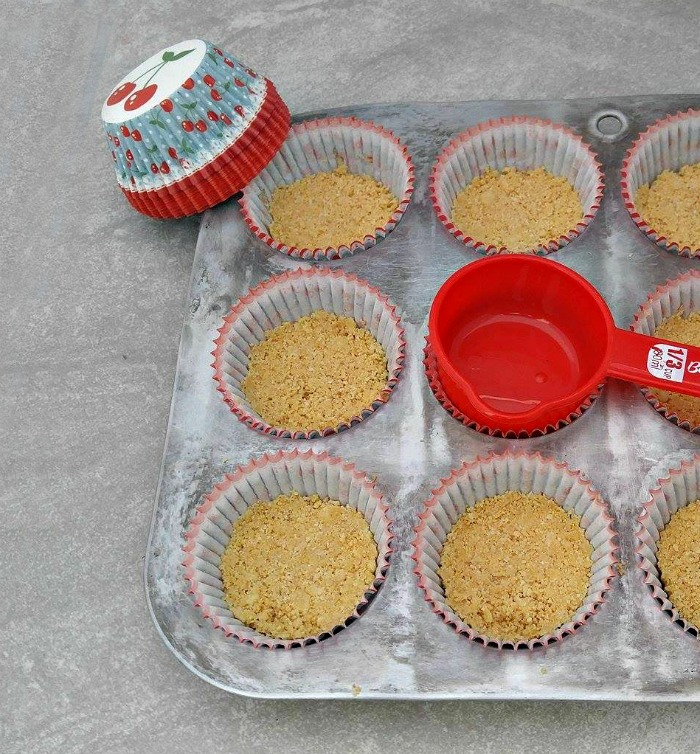 Use a small measuring cup to press down the bases.