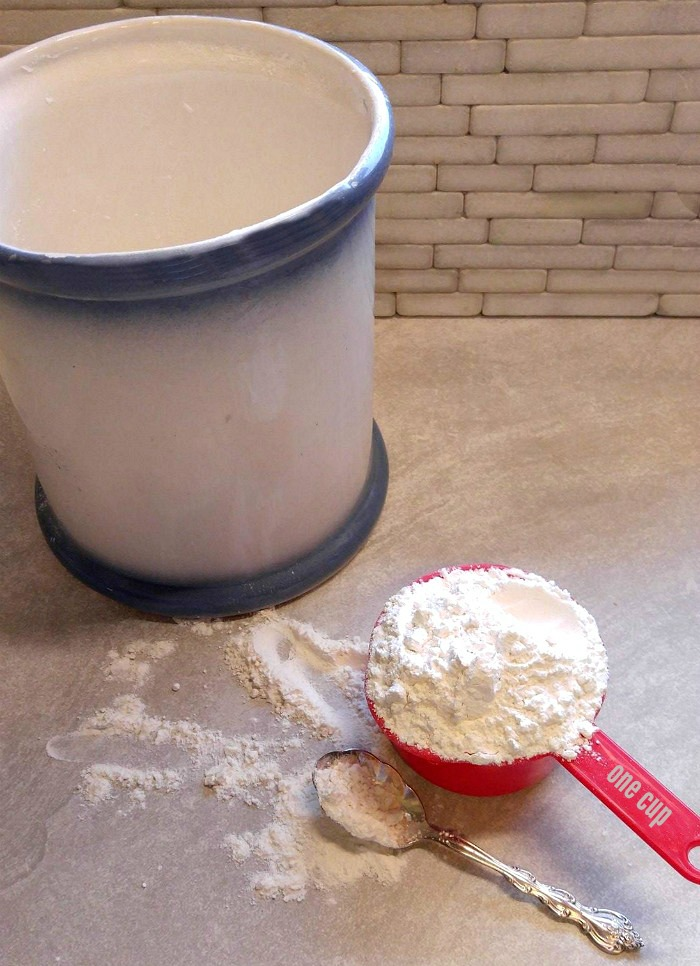 Don't scoop. Spoon the flour into the measuring cup.