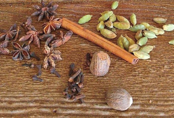 Cardamom, cinnamon stick, anise stars and whole nutmeg.