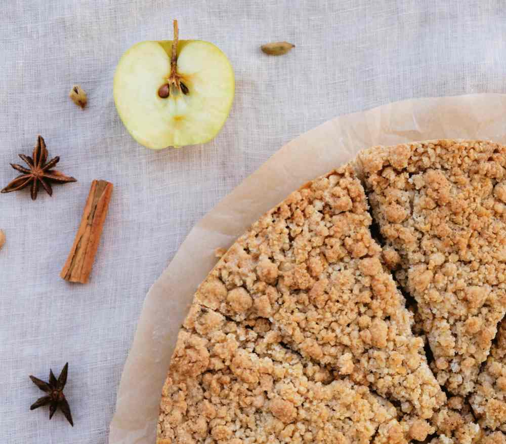 Apple pie with crumb crust and allspice.