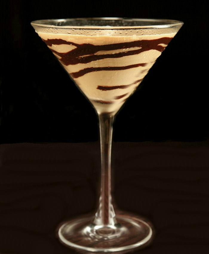 Chocolate drizzle on a martini glass glass