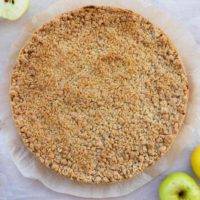 Crumble crust and apples on parchment paper.