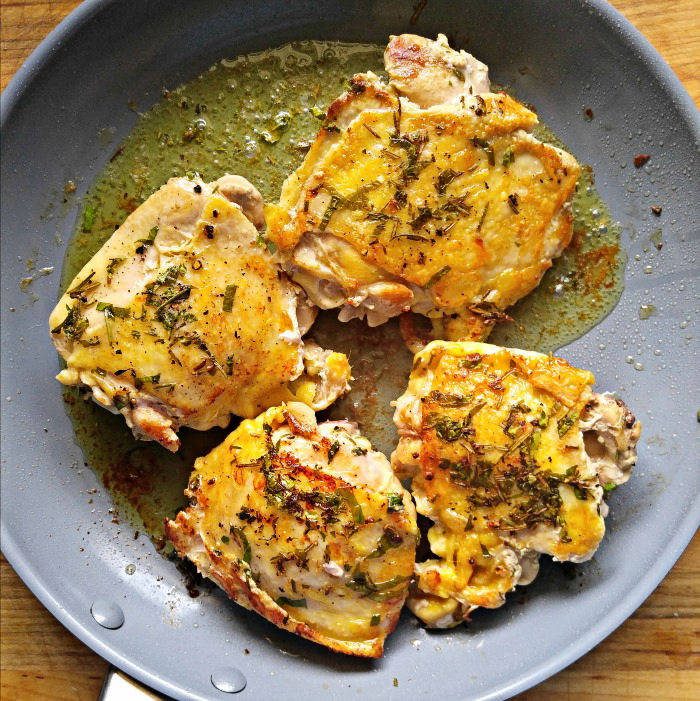 Brown the chicken thighs in butter and olive oil and season with the fresh herbs