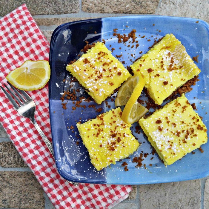 Plate of lemon cheesecake bars