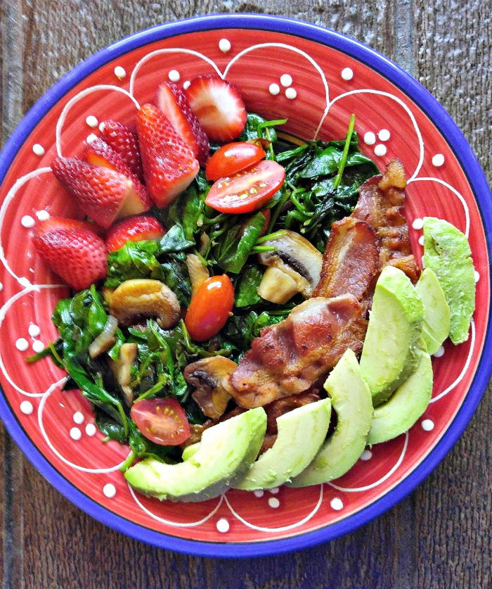 Layers of fruit, bacon, spinach, and mushrooms make up this great breakfast recipe