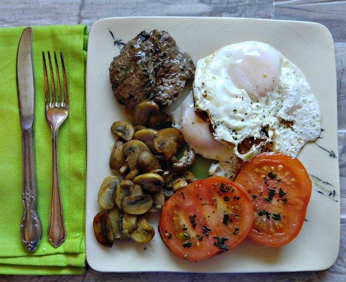 Steak eggs and caramelized mushrooms