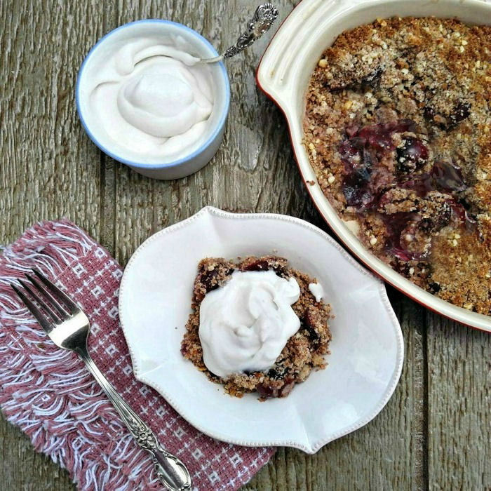 Serving cherry cobbler with whipped coconut cream