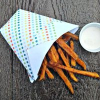 sweet potato fries in a cone with sauce