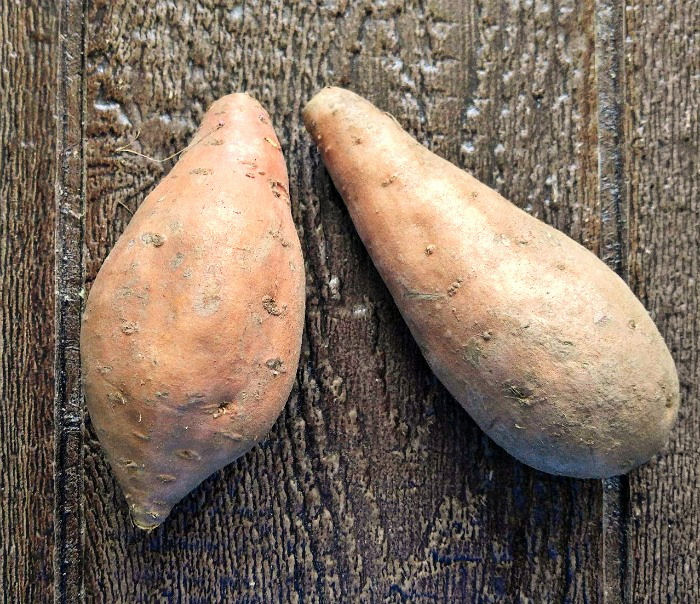 2 sweet potatoes ready for cooking