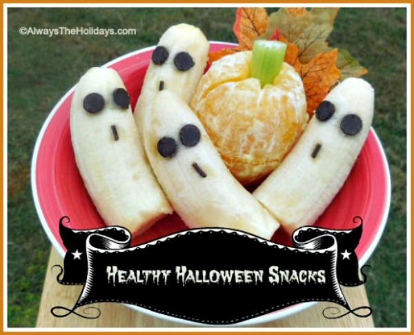 Healthy Halloween snacks - banana ghosts and orange pumpkins